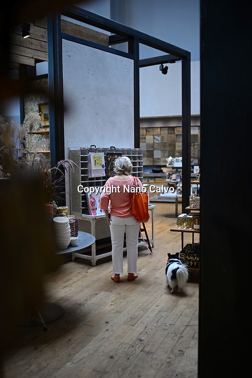 Woman inside Anthropologie store with her dog at The Grove, Los Angeles, California