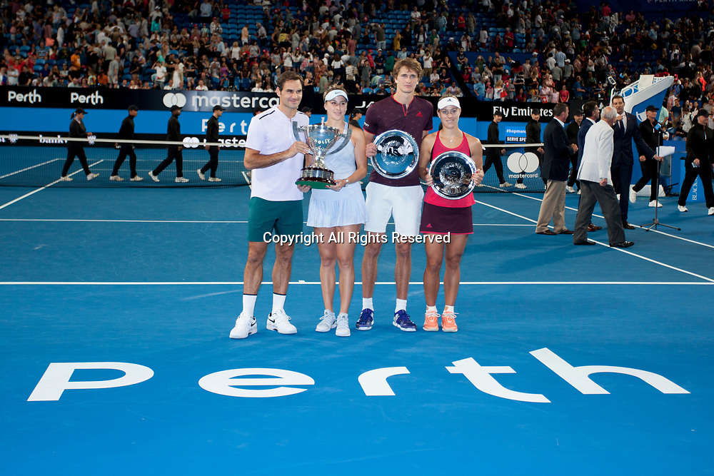 6th January 2018, Perth Arena, Perth, Australia; MasterCard Hopman Cup Tennis Final; Winners Roger Federer and Belinda Bencic of Team Switzerland and Runners up Alexander Zverev and Angelique Kerber of Team Germany pose with their trophies after the Final of the Hopman Cup won by Switzerland