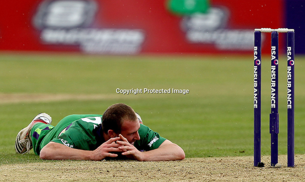 RSA Challenge ODI, Clontarf Cricket Club, Dublin, 25/8/2011<br />Ireland vs England<br />Ireland's John Mooney reacts to missing a opportunity for a run out<br />Mandatory Credit &copy;INPHO/James Crombie  *** Local Caption ***