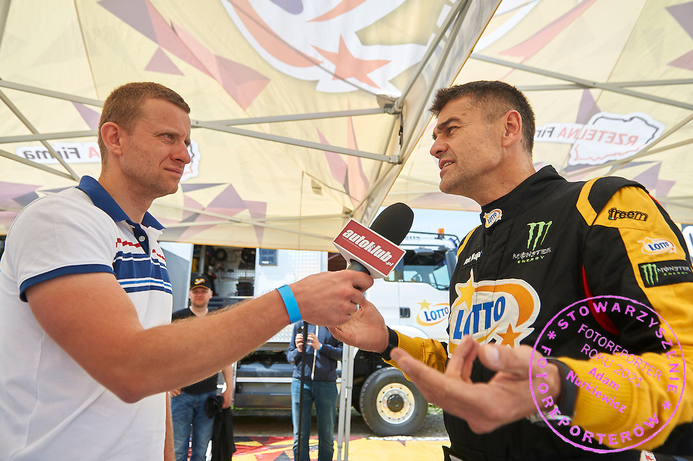 Driver Krzysztof Holowczyc from Poland while tv interview during training session on rally cross track on May 19, 2015 in Slomczyn, Poland<br /> <br /> Poland, Slomczyn, May 19, 2015<br /> <br /> Picture also available in RAW (NEF) or TIFF format on special request.<br /> <br /> For editorial use only. Any commercial or promotional use requires permission.<br /> <br /> Adam Nurkiewicz declares that he has no rights to the image of people at the photographs of his authorship.<br /> <br /> Mandatory credit:<br /> Photo by &copy; Adam Nurkiewicz / Mediasport