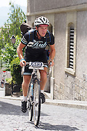 Picture by Andrew Tobin/Tobinators Ltd +44 7710 761829<br /> 04/08/2013<br /> A rider crests a steep cobbled hill during the Cycle Messenger World Championships held in Lausanne, Switzerland. Started in 1993 by Achim Beier from Berlin, the championships are not only a sporting contest but an opportunity to unite friends and bicycle enthusiasts worldwide. The event comprises a number of challenges including a sprint, a track stand (longest time stationary on the bike), a cargo race where heavy loads are carried on special bikes, and the main race. The course winds through central Lausanne and includes bridges, stairs, cobbles, narrow alleyways and challenging hills. The main race simulates the job of a bike courier making numerous drops and pickups across the city. Riders need to check in at specific checkpoints, hand over their delivery and get a new one. The main race can take up to 4 hours for each competitor to complete.