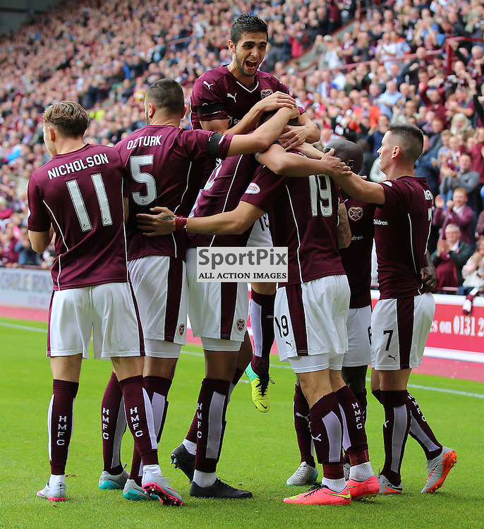 Hearts v St Johnstone Scottish Premiership 2 August 2015; Juanma Delgado Lloria (Hearts, 19) opens his Hearts account and celebrates with team mates during the Heart of Midlothian v St Johnstone Scottish Premiership match played at Tynecastle Stadium, Edinburgh; <br /> <br /> &copy; Chris McCluskie   SportPix.org.uk