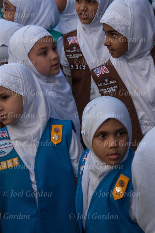 Group of American Muslim  Girl Scouts from Central and Southern New Jersey.<br /> <br /> They are  some of  the many faces of people showing their ethnic pride who were marching and in the 2014 Muslim Day Parade in New York. <br /> <br /> They are wearing the traditional headdress / headdress scarf call a Hijab.