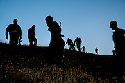 Peshmerga fighters return to their frontline positions, following an early evening training session.  Mount Batiwa, Iraqi Kurdistan.