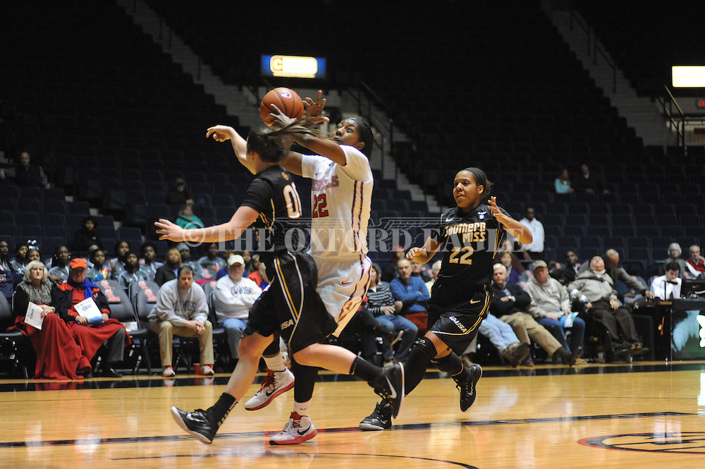 """Southern Mississippi Lady Golden Eagles guard Alex Coyne (00) knocks the ball away from Ole Miss Lady Rebels forward Danielle McCray (22) at the C.M. """"Tad"""" Smith Coliseum in Oxford, Miss. on Thursday, December 18, 2014. (AP Photo/Oxford Eagle, Bruce Newman)"""