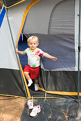 A young boy (age 2) emerges from his tent at the North of Highland Campground near the Cape Cod National Seashore in Truro, Massachusetts.