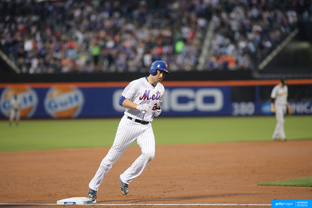 NEW YORK, NEW YORK - June 16: Neil Walker #20 of the New York Mets runs the bases after hitting a home run during the Pittsburgh Pirates Vs New York Mets regular season MLB game at Citi Field on June 16, 2016 in New York City. (Photo by Tim Clayton/Corbis via Getty Images)
