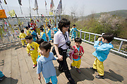 Imjingak. Freedom Bridge, a railway bridge decorated with reunification wishes by South Koreans. Souvenir photo with a group of school kids.