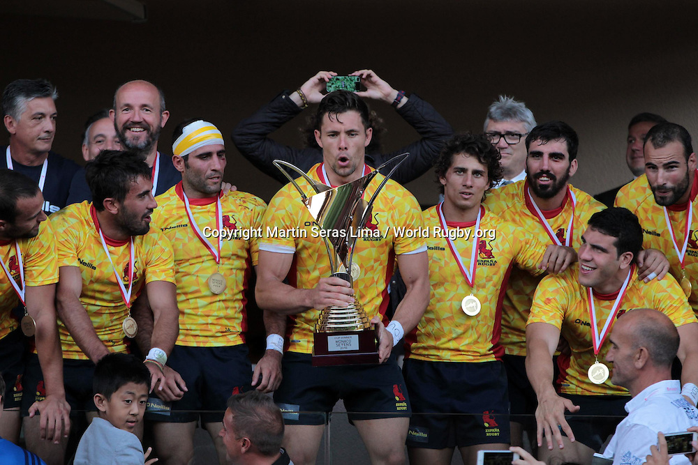 Spain receive the Championship Cup after beating Samoa in the final, Final Cup for Rio Espana 22 v 19 Samoa, Second day at World Rugby Monaco Sevens 2016 at Stade Louis II, Monaco - Photo Martin Seras Lima
