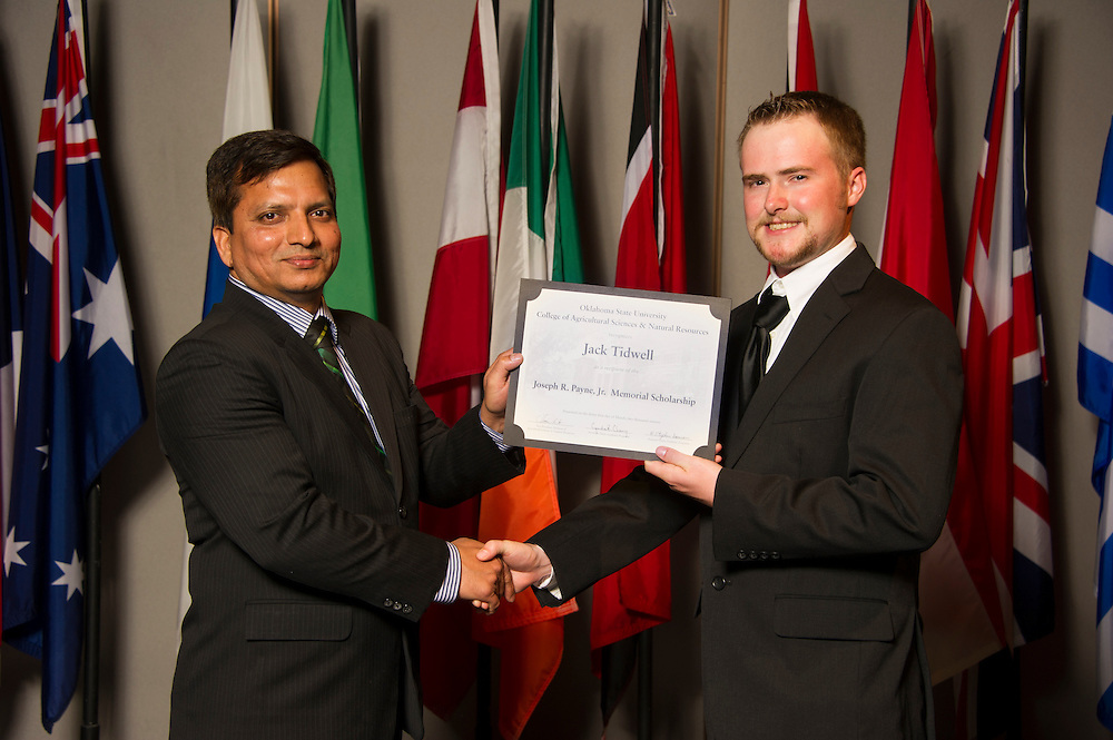 Marlow native Jack Tidwell (right), a natural resource ecology and management major, receives an Oklahoma State University Joseph R. Payne Jr. Memorial Scholarship from OSU associate professor Gopal Kakani (left) at the university's recent College of Agricultural Sciences and Natural Resources Scholarships and Awards Banquet. The scholarship is part of more than $1.4 million in scholarships and awards presented to CASNR students for the 2016-2017 academic year. (Photo by Todd Johnson)
