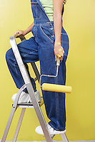 Woman Painting Room on Stepladder