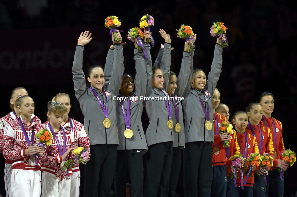 Jul 31, 2012; London, ENGLAND; Mc Kayla Maroney, Jordyn Wieber, Gabrielle Douglas, Alexandra Raisman and Kyla Ross of the United States celebrate on the podium after winning the gold medal in the Artistic Gymnastics Women's Team final on Day 4 of the London 2012 Olympic Games at North Greenwich Arena.