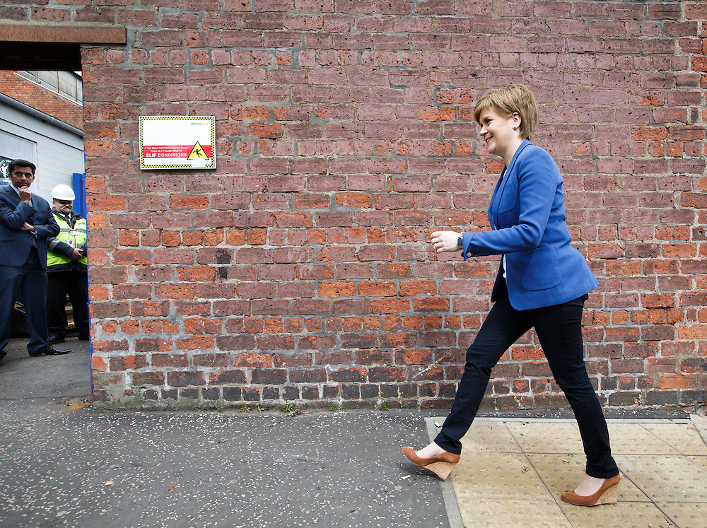 FIRST MINISTER STURGEON TO MEET WORKFORCE AT GOVAN SHIPYARD. Nicola Sturgeon (C) walking along Govan Rd, Glasgow to meet workers at the BAE Shipyard in Govan. With candidates Humza Yousaf (L).  Picture Robert Perry 25th April 2016<br /> <br /> Must credit photo to Robert Perry<br /> FEE PAYABLE FOR REPRO USE<br /> FEE PAYABLE FOR ALL INTERNET USE<br /> www.robertperry.co.uk<br /> NB -This image is not to be distributed without the prior consent of the copyright holder.<br /> in using this image you agree to abide by terms and conditions as stated in this caption.<br /> All monies payable to Robert Perry<br /> <br /> (PLEASE DO NOT REMOVE THIS CAPTION)<br /> This image is intended for Editorial use (e.g. news). Any commercial or promotional use requires additional clearance. <br /> Copyright 2014 All rights protected.<br /> first use only<br /> contact details<br /> Robert Perry     <br /> 07702 631 477<br /> robertperryphotos@gmail.com<br /> no internet usage without prior consent.         <br /> Robert Perry reserves the right to pursue unauthorised use of this image . If you violate my intellectual property you may be liable for  damages, loss of income, and profits you derive from the use of this image.