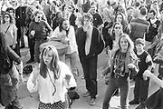 Ravers dancing among crowd, 1st Criminal Justice March, Trafalgar Square, London, UK, 1st of May 1994.