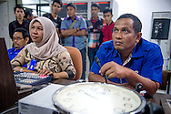 Muammar Ma'aruf works behind the scenes on the taping of a local television show, Keudee Kupi, on November 25, 2014 in Banda Aceh, Indonesia. Muammar is both the set designer and assistant producer on the show at the Television of Republic of Indonesia station in Banda Aceh where he is now employed full time. Ann Hermes/© The Christian Science Monitor 2014