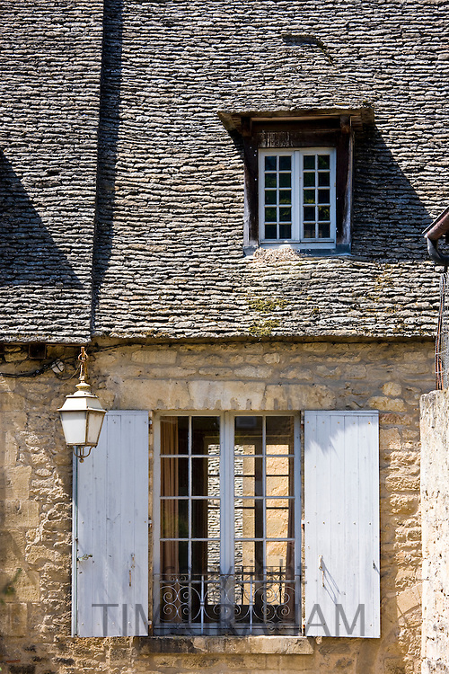 Traditional French window with shutters in Sarlat in the Dordogne, France