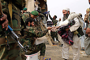 "ANA soldiers from 3rd Brigade, 201st Corps, distribute free humanitarian assistance to villagers during an operation in Tagab Valley.....Colonel Haynes said the battle plan, ""The creeping barrage of goodness,"" to win the hearts and minds of the Tagab Valley includes: a paved road, wells, radio stations, solar power, humanitarian aid, and medical outreach.  Agricultural development teaching how to package goods, and pruning techniques to increase crop yields.  Saffron cultivation started too, as a replacement to poppy.  More projects like schools and police checkpoints will follow as resources allow..."