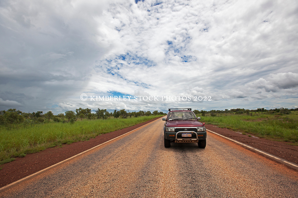 A car on the road between Derby and Fitzroy Crossing in the wet season.