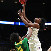 March 31, 2019; Portland, OR, USA; Oregon Ducks forward Ruthy Hebard (24) defends Mississippi State Bulldogs center Teaira McCowan (15) in the first half  of  the Elite Eight of the NCAA Women's Tournament at Moda Center.<br /> Photo by Jaime Valdez
