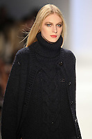 Julia Nobis walks the runway wearing Jill Stuart  Fall 2011 Collection during Mercedes-Benz Fashion Week in New York on February 12, 2011