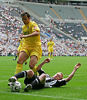 Photo: Andrew Unwin.<br /> Newcastle United v Villarreal. Pre Season Friendly. 05/08/2006.<br /> Newcastle's Damien Duff (R) tries to keep the ball in play.