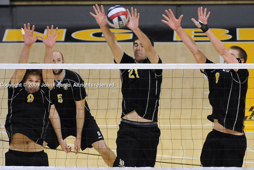Josh Riley(9) Dan Alexander(21) Kyle Friend(6) block the attack in the Mountain Pacific Sports Federation match against Northridge at the Walter Pyramid, Long Beach CA, Saturday, April 11, 2009.  Long Beach State wins the match in four sets 34-32, 30-25, 23-30, 30-25.