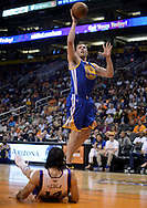 Apr 5, 2013; Phoenix, AZ, USA; Golden State Warriors forward David Lee (10) commits an offensive foul against the Phoenix Suns forward Luis Scola (14) in the first half at US Airways Center. Mandatory Credit: Jennifer Stewart-USA TODAY Sports