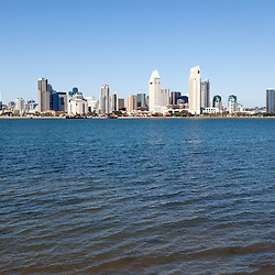 High resolution photo of San Diego cityscape downtown city buildings and waterfront during the day accross San Diego Bay in Southern California.