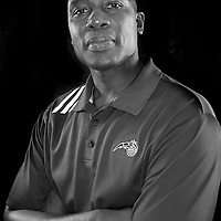 Orlando Magic head coach Jacque Vaughn poses in front of a backdrop during the Orlando Magic media day event at the Amway Arena on Monday, September 30, 2103 in Orlando, Florida. (AP Photo/Alex Menendez)
