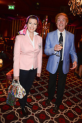 DAVID WIGG and CLEO ROCOS at a party to celebrate the publication of 'Passion for Life' by Joan Collins held at No41 The Westbury Hotel, Mayfair, London on21st October 2013.