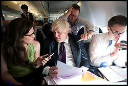 London Mayor Boris Johnson being interviewed on the plane to Mumbai from Hyderabad, on the forth day of a six-day tour of India, where he will be trying to persuade Indian businesses to invest in London, Wednesday November 28, 2012. Photo by Andrew Parsons / i-Images