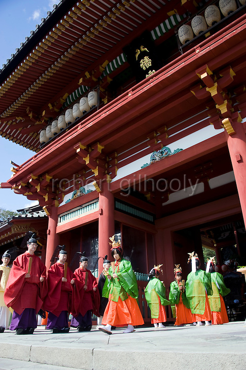 Priests attend a ritual in front of the inner sanctuary  during the annual Reitaisai Grand Festival at Tsurugaoka Hachimangu Shrine in Kamakura, Japan on  14 Sept. 2012.  Sept 14 marks the first day of the 3-day Reitaisai festival, which starts early in the morning when shrine priests and officials perform a purification ritual in the ocean during a rite known as hamaorisai and limaxes with a display of yabusame horseback archery. Photographer: Robert Gilhooly