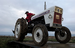 © Licensed to London News Pictures. <br /> 30/11/2014. <br /> <br /> Boulby, United Kingdom<br /> <br /> James Jobson from Hartlepool reverses his David Brown Selectamatic 990 tractor from a trailer at the start of the ploughing match that takes place each year on fields next to the picturesque Yorkshire coastline near Staithes. Farmers attend each year to demonstrate their ploughing skills and to help raise money for charity with proceeds from this year going to Charlie Brown Cancer Care in Newcastle.<br /> <br /> <br /> Photo credit : Ian Forsyth/LNP