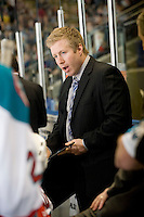 KELOWNA, CANADA, JANUARY 1: Ryan Cuthbert, assistant coach of the Kelowna Rockets speaks to the players on the bench as the Calgary Hitmen visit the Kelowna Rockets on January 1, 2012 at Prospera Place in Kelowna, British Columbia, Canada (Photo by Marissa Baecker/Getty Images) *** Local Caption ***
