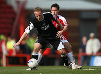 Photo: Rich Eaton.<br /> <br /> Bristol City v Swansea City. Coca Cola League 1. 07/04/2007. Thomas Butler left of Swansea holds off Bristols Lee Johnson