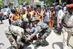 June 6, 2017 - Guwahati, India - Activist of the Communist Party of India (Marxist) being whisked away by police while staging a protest demonstration, protesting against price hike on essential commodities in front of  Prasanti Uddyan. (Credit Image: © Rajib Jyoti Sarma/Pacific Press via ZUMA Wire)