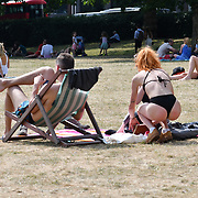 A girl wearing bikini sunbathing in hot weather at Green Park, London, UK on July 1st 2018.
