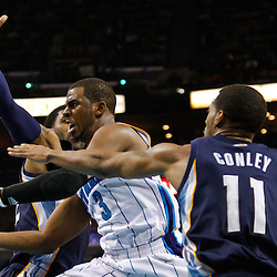 January 19, 2011; New Orleans, LA, USA; New Orleans Hornets point guard Chris Paul (3) shoots between Memphis Grizzlies point guard Mike Conley (11) and shooting guard O.J. Mayo (32) during the third quarter at the New Orleans Arena. The Hornets defeated the Grizzlies 130-102 in overtime.  Mandatory Credit: Derick E. Hingle