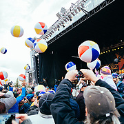 """Micahel Franti and Spearhead perform to a packed crowd in Teton Village, Wyoming. Beach balls bouncing througout the crowd during song """"The Sound of Sunshine""""."""