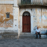 Two old men taking a break in the town square of Ravello, Italy.