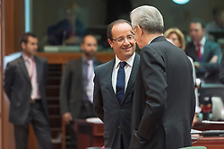 Francois Hollande, France's president, left, speaks with Mario Monti, Italy's prime minister, during the EU Summit, at the European Council headquarters in Brussels, Belgium on Friday, Oct. 19, 2012. (Photo © Jock Fistick)