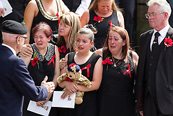© Licensed to London News Pictures . 12/07/2013 . Bury , UK . After the service . The funeral for Fusilier Lee Rigby at Bury Parish Church in Bury town centre today (Friday 12th July 2013) , watched by 100s of people . Fusilier Rigby's coffin was held in Bury Parish Church overnight , watched over by an honour guard of soldiers from the 2nd Battalion Royal Regiment of Fusiliers ( 2RRF ) . Rigby was brutally murdered in Woolwich , London on 22nd May 2013 . Photo credit : Joel Goodman/LNP