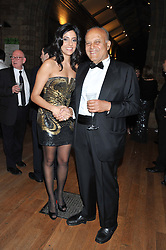Left to right, SHERINE SAWIRIS and PROF.SIR MAGDI YACOUB at the annual Chain of Hope's annual Gala Ball held at the Natural History Museum, London on 8th November 2012.