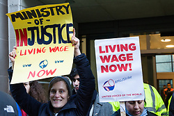 London, UK. 22nd January, 2019. Receptionists, security guards and cleaners at the Ministry of Justice (MoJ) represented by the United Voices of the World (UVW) trade union stand on the early morning picket line after beginning a strike for the London Living Wage of £10.55 per hour and parity of sick pay and annual leave allowance with civil servants. The strike is being coordinated with support staff at the Department for Business, Energy and Industrial Strategy (BEIS) from the Public and Commercial Services (PCS) union.