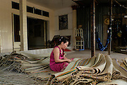 A woman makes jute mats on Binh Thanh Island, Vietnam.
