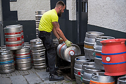 © Licensed to London News Pictures. 03/07/2020. London, UK. Beer barrels arrive at the Windsor Castle pub in South Kensington, west London, ahead of pubs reopening tomorrow (Sat). Restaurants, pubs and Cafe's will reopen for the first time since lockdown was introduced to prevent the spread of the COVID-19 strain or Coronavirus. Photo credit: Ben Cawthra/LNP