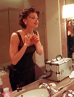 LS.Ashley Judd#2.0228.MY<br />Beverly Hills<br />Actress Ashley Judd tries on a Harry Winston black pearl necklase as she prepares to host the Academy Awards sci-tech awards at the Regent Beverly Wilshire Hotel Saturday February 28.<br />Photo/Art by:Marilynn Young