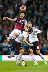 Rudy Gestede of Aston Villa climbs Daley Blind of Manchester United to head the ball - Mandatory byline: Rogan Thomson/JMP - 07966 386802 - 14/08/2015 - FOOTBALL - Villa Park Stadium - Birmingham, England - Aston Villa v Manchester United - Barclays Premier League.