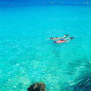 Couple snorkeling. Cozumel, Quintana Roo. Mexico.