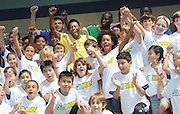 Soccer legend Pele, center in yellow jersey, cheers with soccer campers at Chelsea Piers in New York, Thursday, July 31, 2013, as SUBWAY restaurants names Pele as their newest global brand ambassador. (Photo by Diane Bondareff/Invision for SUBWAY restaurants/AP Images)